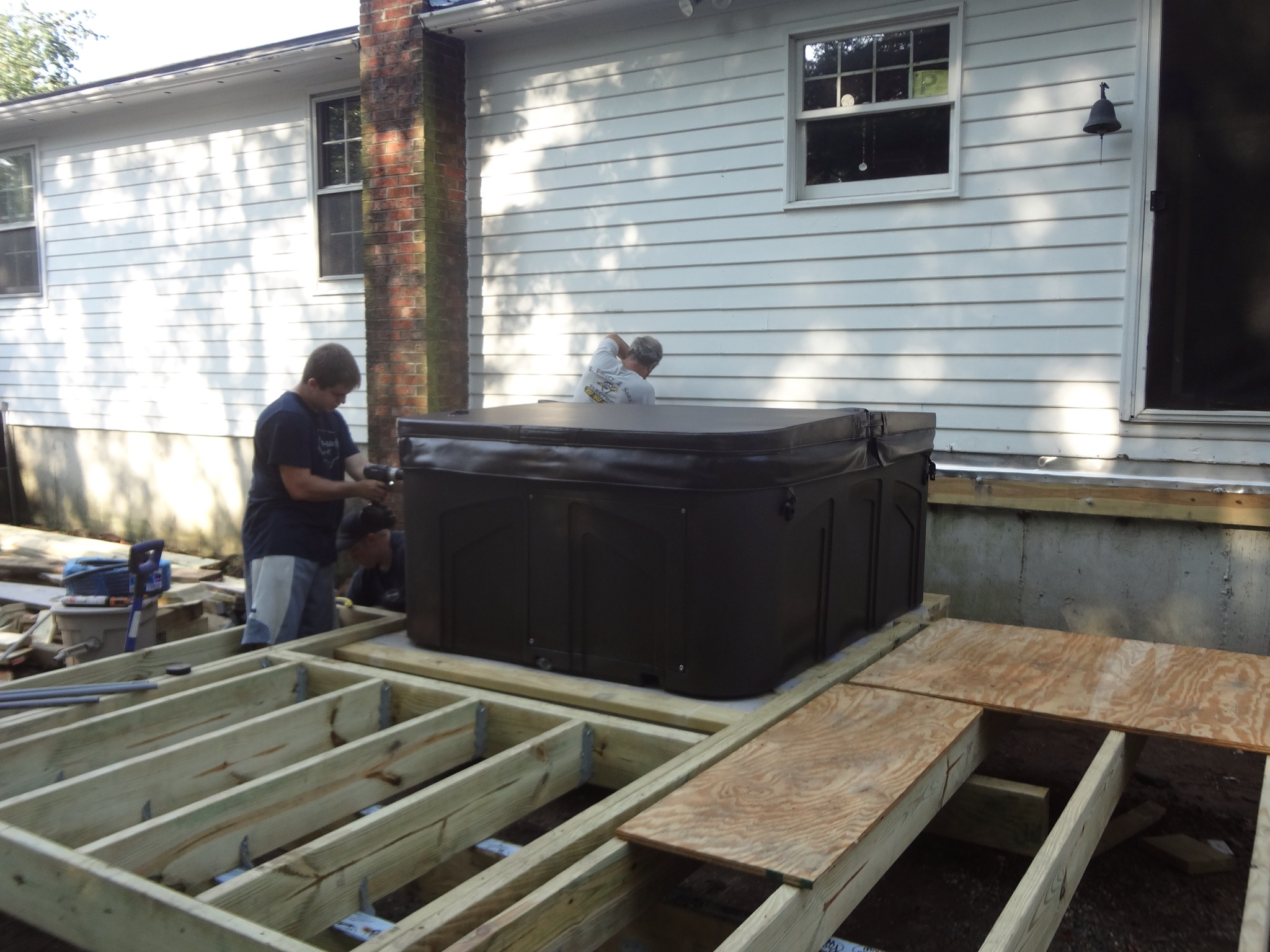 we got the lower deck framed just in time for the hot tub to be delivered the electrician arrived at the same time to add a dedicated circuit and move the